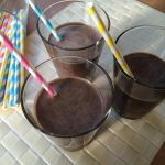 carob smoothies in 3 glass tumblers
