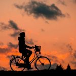 cyclist with sunset background