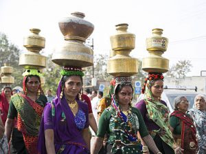 Women in Rajasthan, India carrying water pots