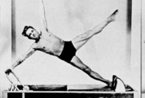 Joseph Pilates on the Trapeze Table (a piece of Pilates Studio equipment)