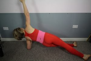 reader in side lying pose with pelvis lifted