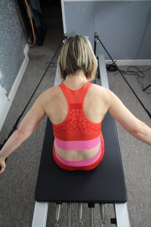 author doing part of the Rowing series on the Reformer