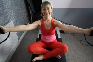 reader on the reformer. exercise is hug a tree