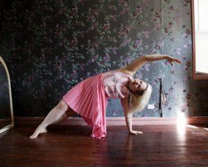 lady with glamorous clothing doing pilates