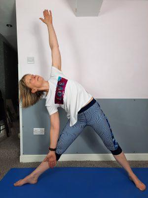 Author doing Yoga: the Triangle pose