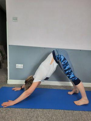 Author doing Downward Dog Yoga Pose