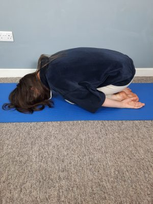 Author's daughter doing Child Pose in YOga